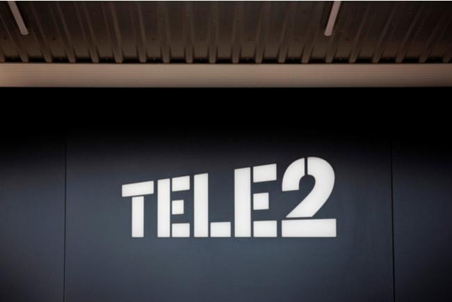 svart vägg med texten Tele2
